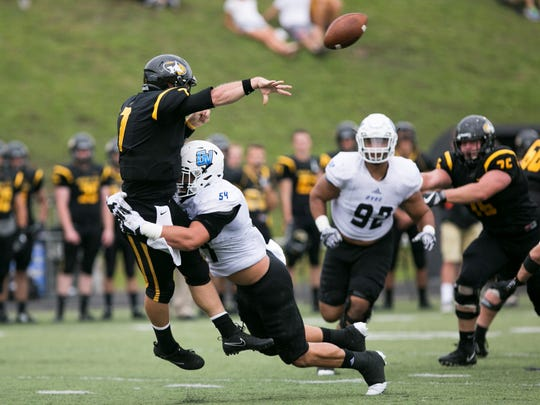Grand Valley State's Dylan Carroll, shown pressuring the quarterback during a game against Michigan Tech, is headed to NFL mini camp with the Chicago Bears