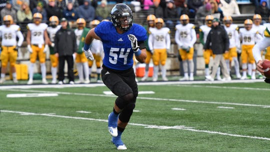 Grand Valley defensive end and Portland grad Dylan Carroll signed to attend mini camp with the Chicago Bears.