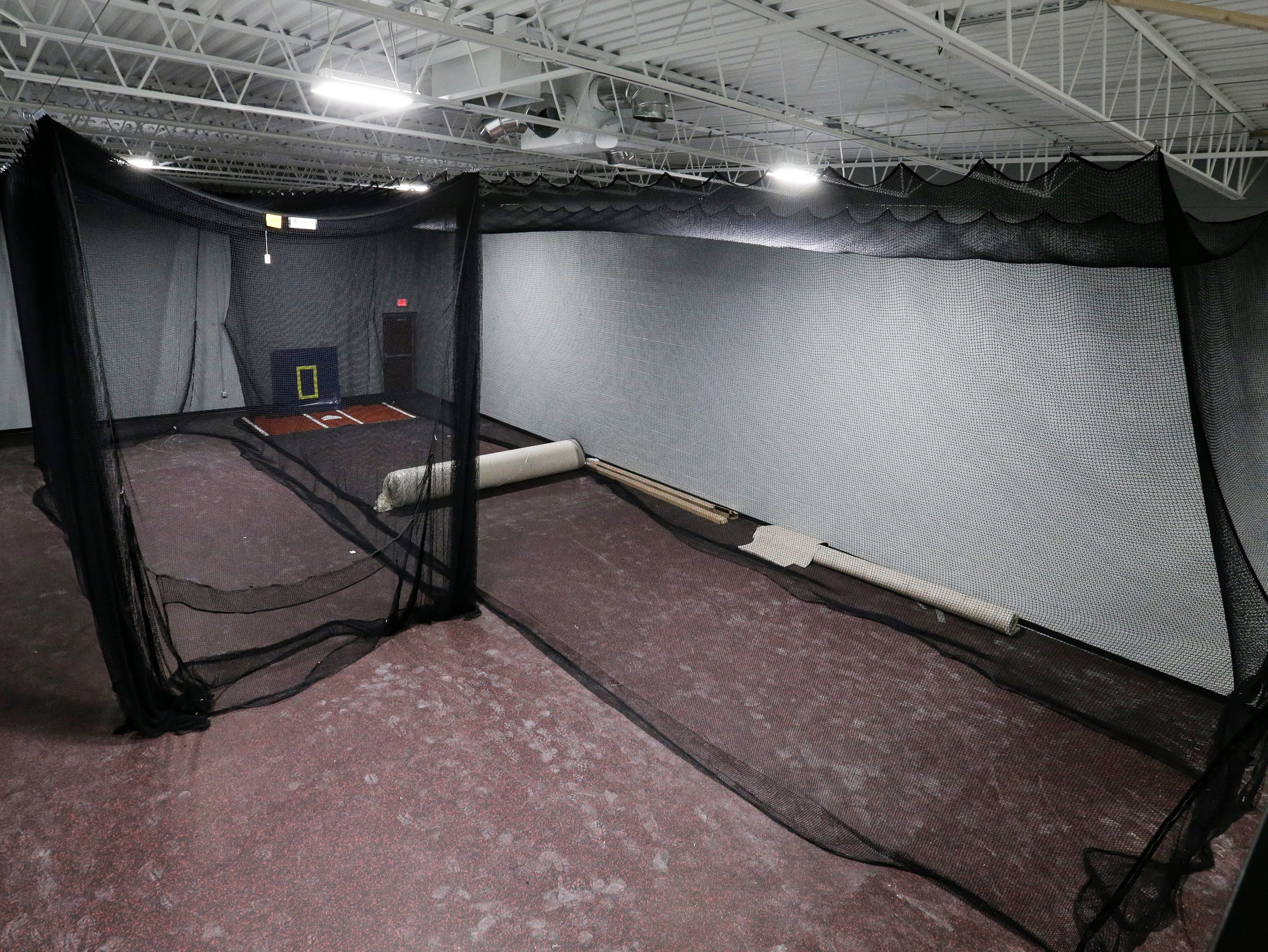 The batting cages at Strand Adventures Wednesday, May 1, 2019, in Manitowoc, Wis. The cages can also be removed to create an open event space. Joshua Clark/USA TODAY NETWORK-Wisconsin