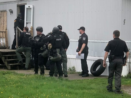 Officers raid a Crestline trailer Tuesday afternoon.