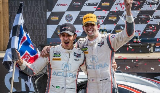 Team Penske's Hélio Castroneves and Ricky Taylor celebrate their win during the Acura Sports Car Challenge at Mid-Ohio last year.