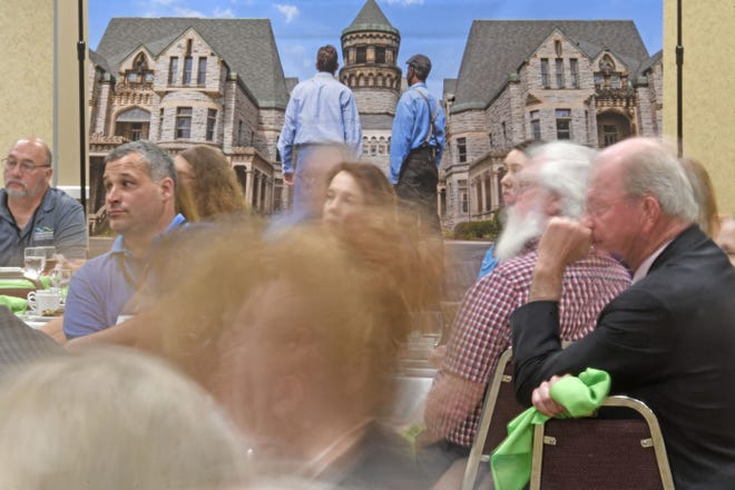 Visitors listen to a list of events scheduled this year in the Mansfield/Richland County area Wednesday afternoon during the Destination Mansfield annual meeting at the Mid-Ohio Conference Center.