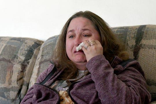 Lisa Carroll cries as she recalls the day her daughter Kaitlyn Carroll-Peak was murdered by Kaitlyn's boyfriend Dakota Steagall.
