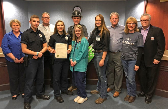 From left, front, areNicholas Coder, TRCC Criminal Justice; Allyson Baughman, TRCC Criminal Justice; LeAnna Dunn, TRCC Health Careers Academy; Brittany Fitch, TRCC Welding; andEllen Messenger, Tri-Rivers; and back,Tami Galloway, Marion Technical College;  Commissioner Andy Appelfeller; Mathew Sayers, TRCC Construction Trades Academy; Commissioner Kerr Murray; and Ron Meade, Ohio Means Jobs-Marion.