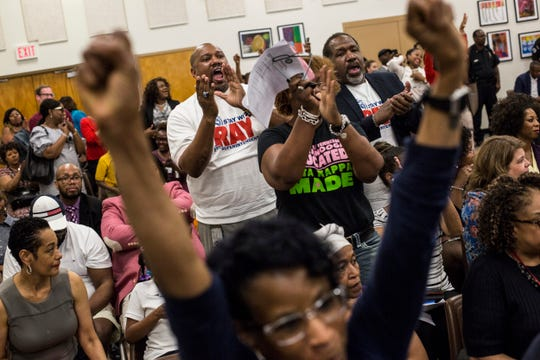 Supporters of interim Superintendent Joris Ray react after the Shelby County School Board voted on Tuesday night to hire Ray permanently to the post.