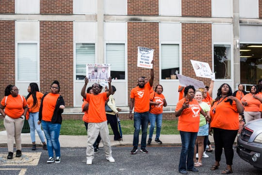 People who supported a national search for a new Shelby County Schools Superintendent protested outside after Tuesday's meeting of the Shelby County School Board, April 30, 2019. The Shelby County School Board voted on Tuesday night to hire interim Superintendent Joris Ray permanently to the post, halting its plans for a national search for a new leader.