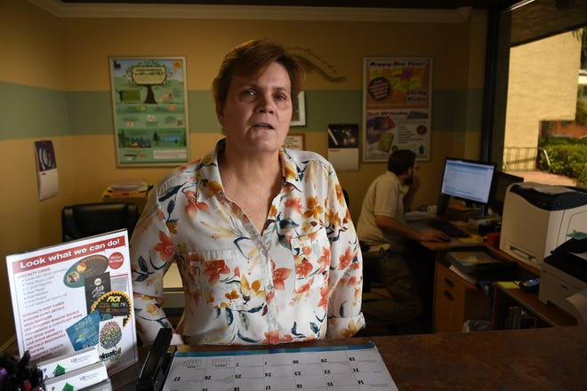 Linda Bicking works the counter at The Print Shop, where she is manager. Bicking has started a GoFundMe account, hoping to raise funds to pay for cancer surgery she cannot afford.