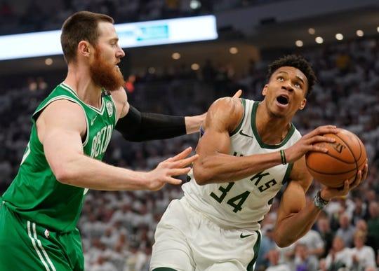 Milwaukee Bucks' Giannis Antetokounmpo looks to shoot past Boston Celtics' Aron Baynes during the first half of Game 2 of a second round NBA basketball playoff series Tuesday, April 30, 2019, in Milwaukee. (AP Photo/Morry Gash)