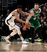 Bucks forward Giannis Antetokounmpo plays stingy defense against  Boston Celtics center Aron Baynes.