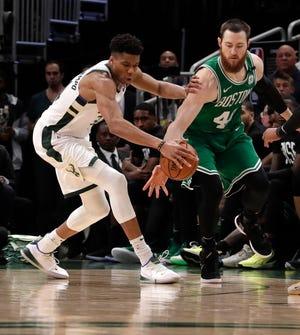 Bucks forward Giannis Antetokounmpo plays stingy defense against  Boston Celtics center Aron Baynes.