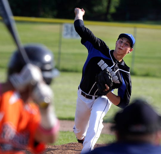 Reagan Pitcher Alec Marsh (8) delivers a pitch during the Milwaukee Reagan-Milwaukee Riverside baseball game at Hardin Park, Thursday, May 28, 2015.