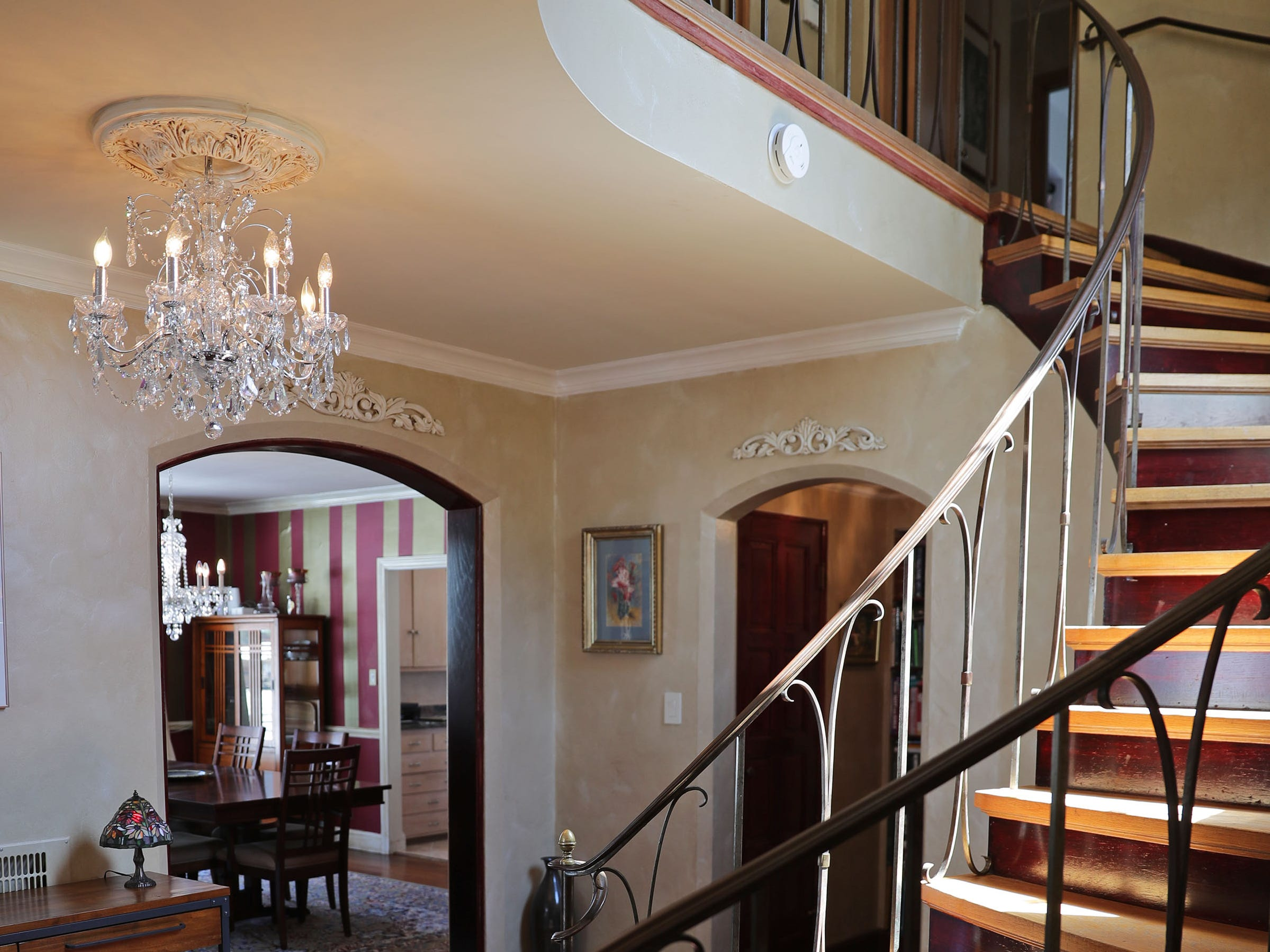 A curved stairway leads from the foyer area to the upper level.