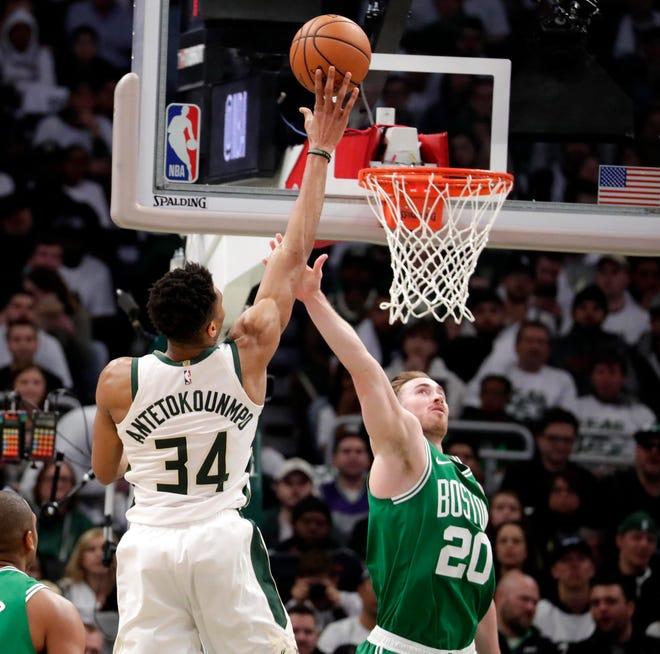 Bucks forward Giannis Antetokounmpo shoots over Gordon Hayward.