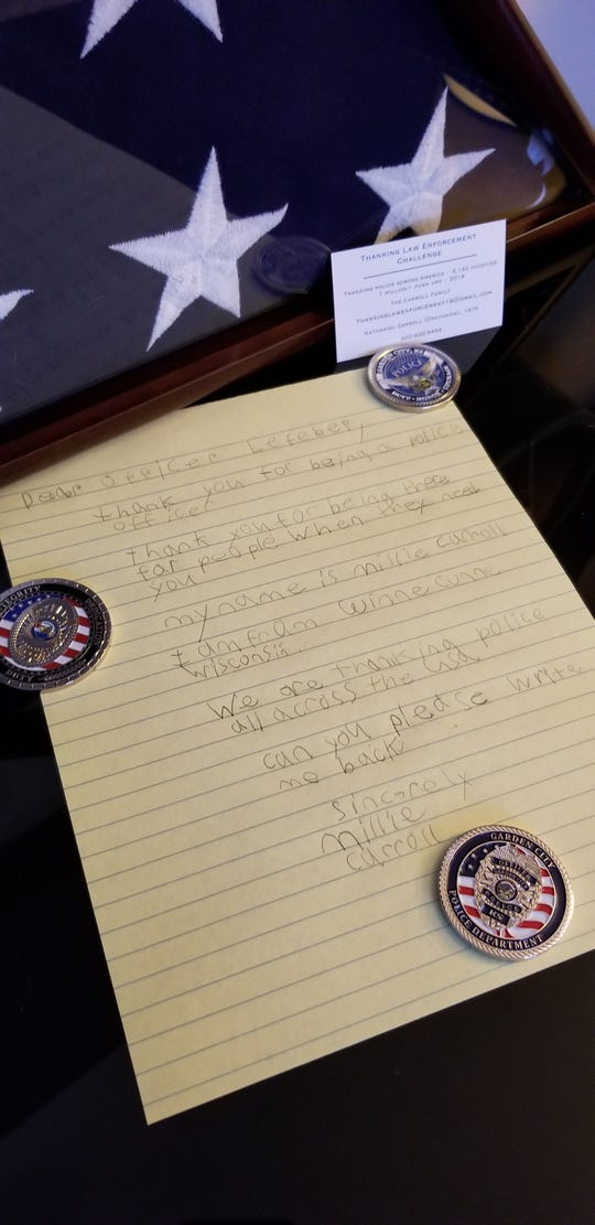 Nate Carroll's children write letters of gratitude and praise to police officers across the country. Sometimes they receive a return letter along with police patches or collector coins.