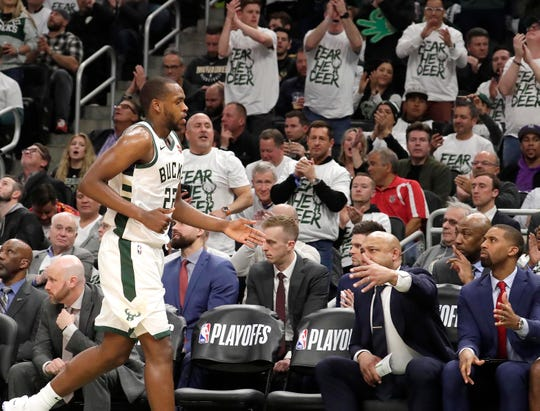 Milwaukee Bucks forward Khris Middleton (22) leaves the game with 28 points during the Milwakee Bucks 123-102 win over the Boston Celtics during the NBA Playoffs in Milwaukee, Tuesday, April 30, 2019.  Rick Wood/Milwaukee Journal Sentinel ORG XMIT:  00098289B