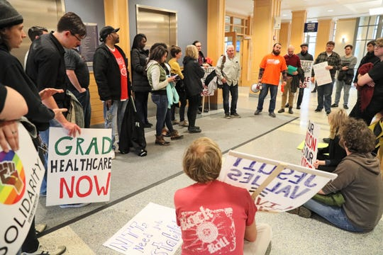 Students rally in Zilber Hall, where the administration has offices, Wednesday. Marquette University non-tenure track faculty and graduate workers held a May Day rally to demand the administration issue a written commitment to a fair process to form their union.
