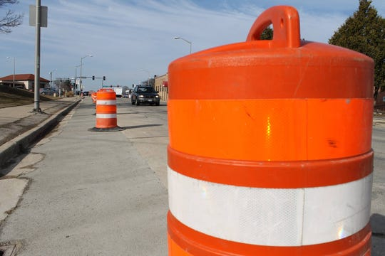 Traffic cones sit on the edge of National Avenue in West Allis for a four-block road repair project that is expected to run until mid-August.