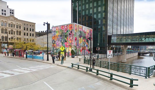"""A conceptual rendering of Carlos Rolón's planned installation for Sculpture Milwaukee 2019, """"Gild the Lily (Caribbean Hybrid I, II, III)."""" The Chicago-based artist plans to sheath the outside of the lobby cube of the Chase Bank building with a translucent diorama of tropical flora."""