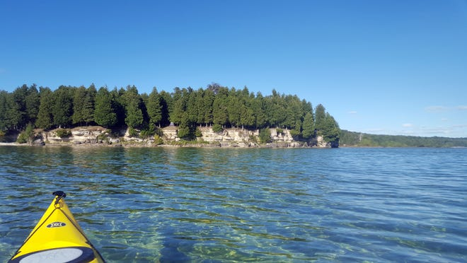 A campsite is perched on a rocky bluff on Rock Island State Park north of Door County.