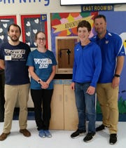 NWA3D representatives Drew Wallis and Carly Palmer (far left) presented Mountain Home Junior High School student Will Beckham and EAST instructor David Martin with checks for $1,000 on Monday.