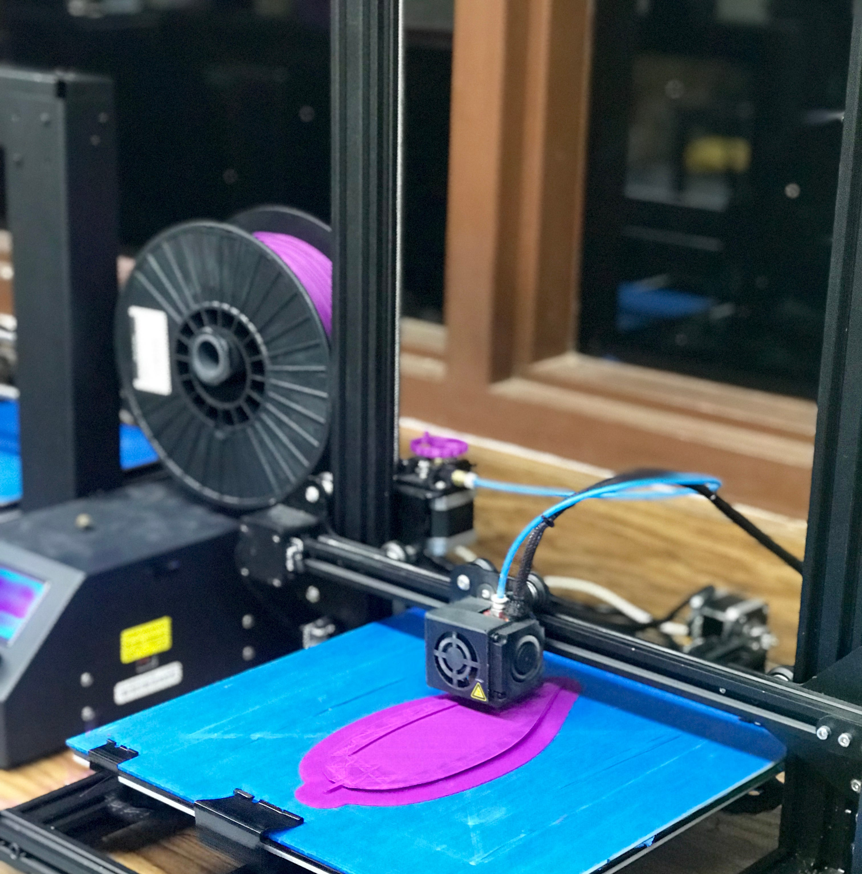 Students win awards, demonstrate ingenuity using 3D printers to create unique game, clamp