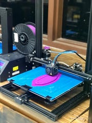 A 3D printer builds a toy boat for the 'Code Your Boat' game developed by five Mountain Home High School EAST students.