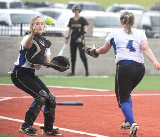 Mountain Home catcher Tori Robb and Chassie Whitlow converge on the ball during the Lady Bombers' win over Nettleton on Tuesday night.