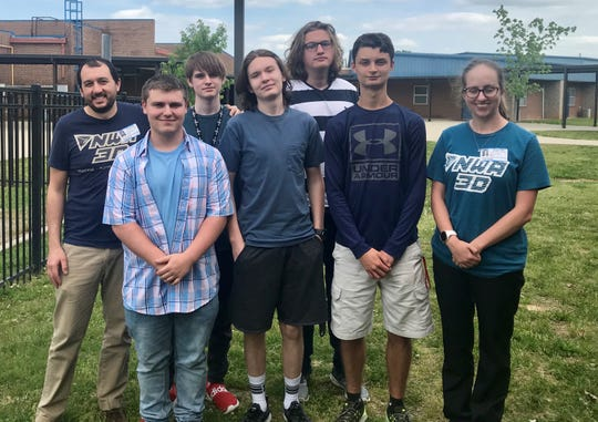 Members of the 'Code Your Boat' team pose for a photo with NWA3D co-founder Drew Wallis (far left) and NWA3D printer technician Carly Palmer (far right) on Monday. Team members include (from left) Trey McFarland, Oden Smith, Will Lauerman, Jake Grant and Tyler Sosnowski.