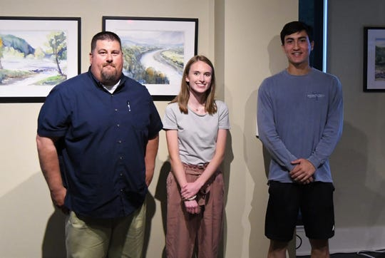 Science instructor Tom Ethridge (far left) joined Mountain Home students Luke Kruse and Kennedy Wyatt in representing the 22 Mountain Home students participating in the ongoing testing of Dodd Creek's water quality at Monday night's Friends of the North Fork and White Rivers annual meeting.