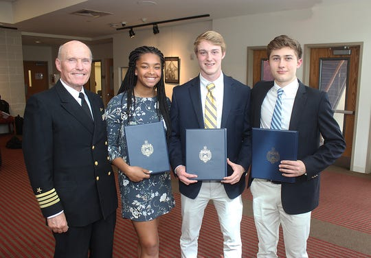 U.S. Navy Captain Captain Rick McGoey visits the Morristown-Beard School to welcome seniors Sarah Williams, George Burke and John Trombetta to the Naval Academy Class of 2023. April 30, 2019.