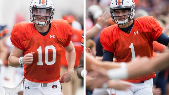 Auburn quarterbacks Bo Nix (left) and Joey Gatewood (right) take the field before A-Day on Saturday, April 13, 2019.
