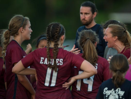 Montgomery Academy coach Carter Tuck pumps up her team after the game at Montgomery Academy in Montgomery, Ala., on Tuesday, April 30, 2019. Montgomery Academy defeated Trinity 6-0.
