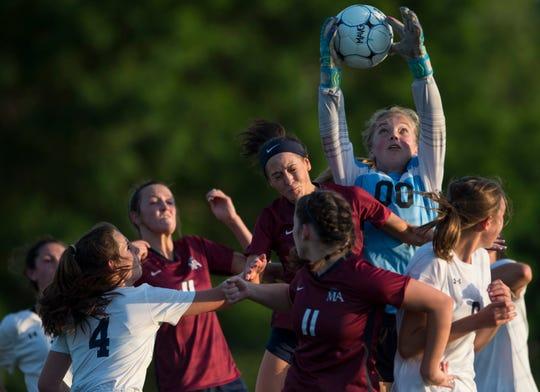 Trinity's MaryCollin McDuffee (0) grabs the ball on a corner kick at Montgomery Academy in Montgomery, Ala., on Tuesday, April 30, 2019. Montgomery Academy defeated Trinity 6-0.
