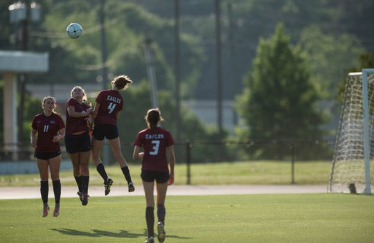Montgomery Academy players attempt to block a free kick at Montgomery Academy in Montgomery, Ala., on Tuesday, April 30, 2019. Montgomery Academy defeated Trinity 6-0.