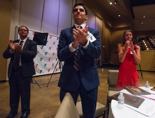 Trey Lindsey, III, of Montgomery Academy, and Isabelle Cochran, of Catholic High School, applause for the other nominees after they are named the Jimmy Hitchcock Award winners during an awards banquet at Frazer United Methodist Church in Montgomery, Ala., on Tuesday evening April 30, 2019.