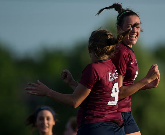 Montgomery Academy's Martha Robertson (9) and Leighton Robertson (4) celebrate Robertson's goal at Montgomery Academy in Montgomery, Ala., on Tuesday, April 30, 2019. Montgomery Academy defeated Trinity 6-0.