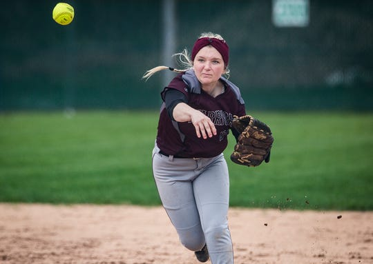 Wes-Del's Teasha Racalto throws to first against Delta during their game at Wes-Del High School Tuesday, April 30, 2019.