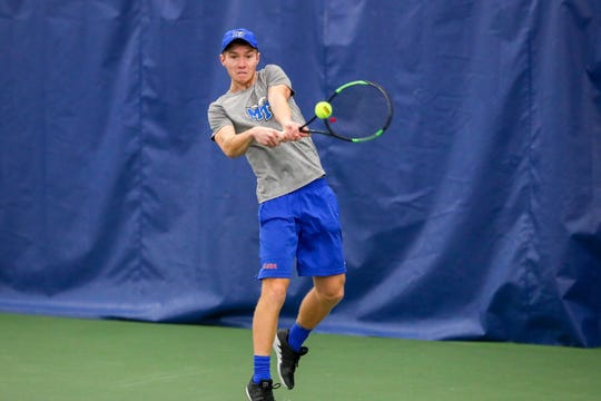 MTSU's Pavel Motl sends a shot back during a match earlier in the season.
