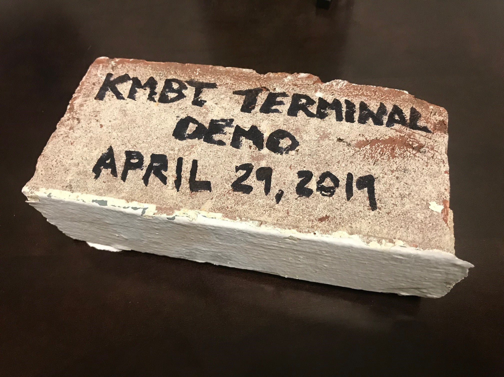 A piece of brick from the Murfreesboro Airport terminal is marked with the day the building was demolished. It was originally built in 1952.