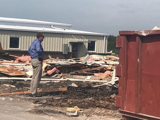 Murfreesboro Airport Airport Manager Chad Gerkhe looks over the debris left behind following the demolition of the airport terminal on Monday, April 29.