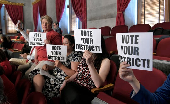 Area teachers hold signs in the gallery during session in House of Representatives in Nashville on Wednesday, May 1, 2019.