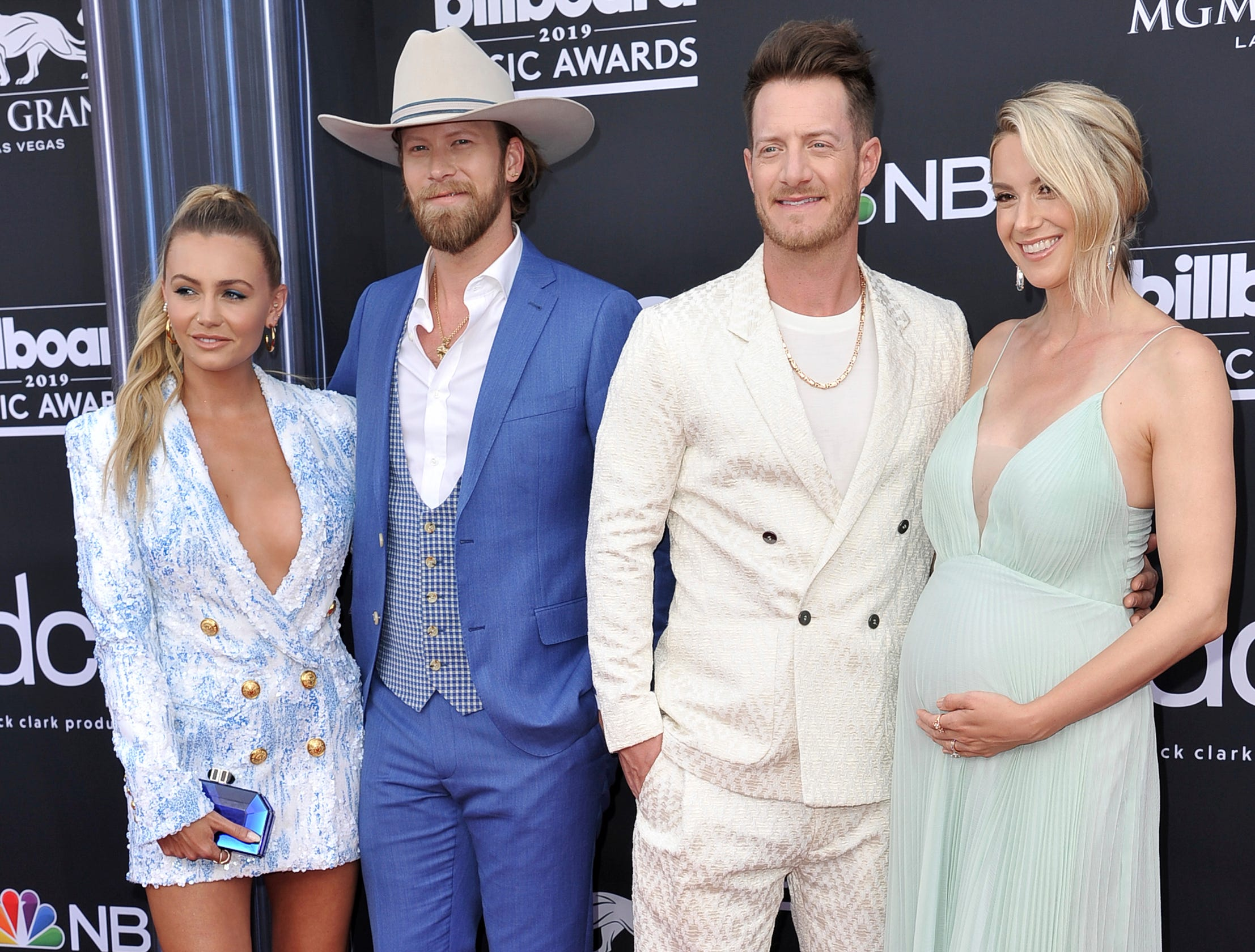 Brittney Marie Cole, from left, Brian Kelley and Tyler Hubbard, of Florida Georgia Line, and Hayley Stommel arrive at the Billboard Music Awards on Wednesday, May 1, 2019, at the MGM Grand Garden Arena in Las Vegas.