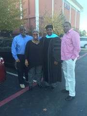 Devin DeLaughter in 2015 at graduation for his doctorate of education degree from Dallas Baptist University. From left to right, James and Gloria Johnson, his mentors and former guardians whom he calls his parents, DeLaughter, and DeLaughter's brother, Tim