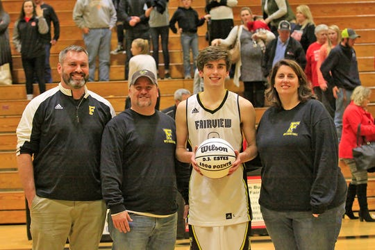 Fairview High Basketball guard #3 D.J. Estes was awarded a 1000 point ball during game vs. Hickman County on December 11, 2018. (l-r) Fairview Basketball Coach Trey McCoy, Dad David Estes, D.J. Estes, Mom Suzie Estes.