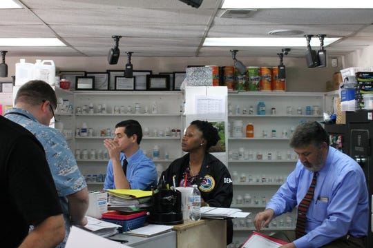 DEA officers visiting a pharmacy in Celina, Tennessee.