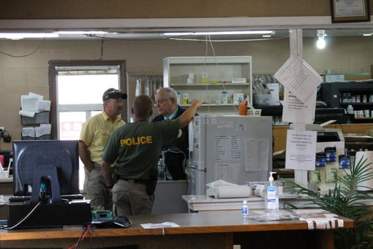 DEA personnel at a pharmacy in Celina, Tennessee. File / Citizen-Statesman