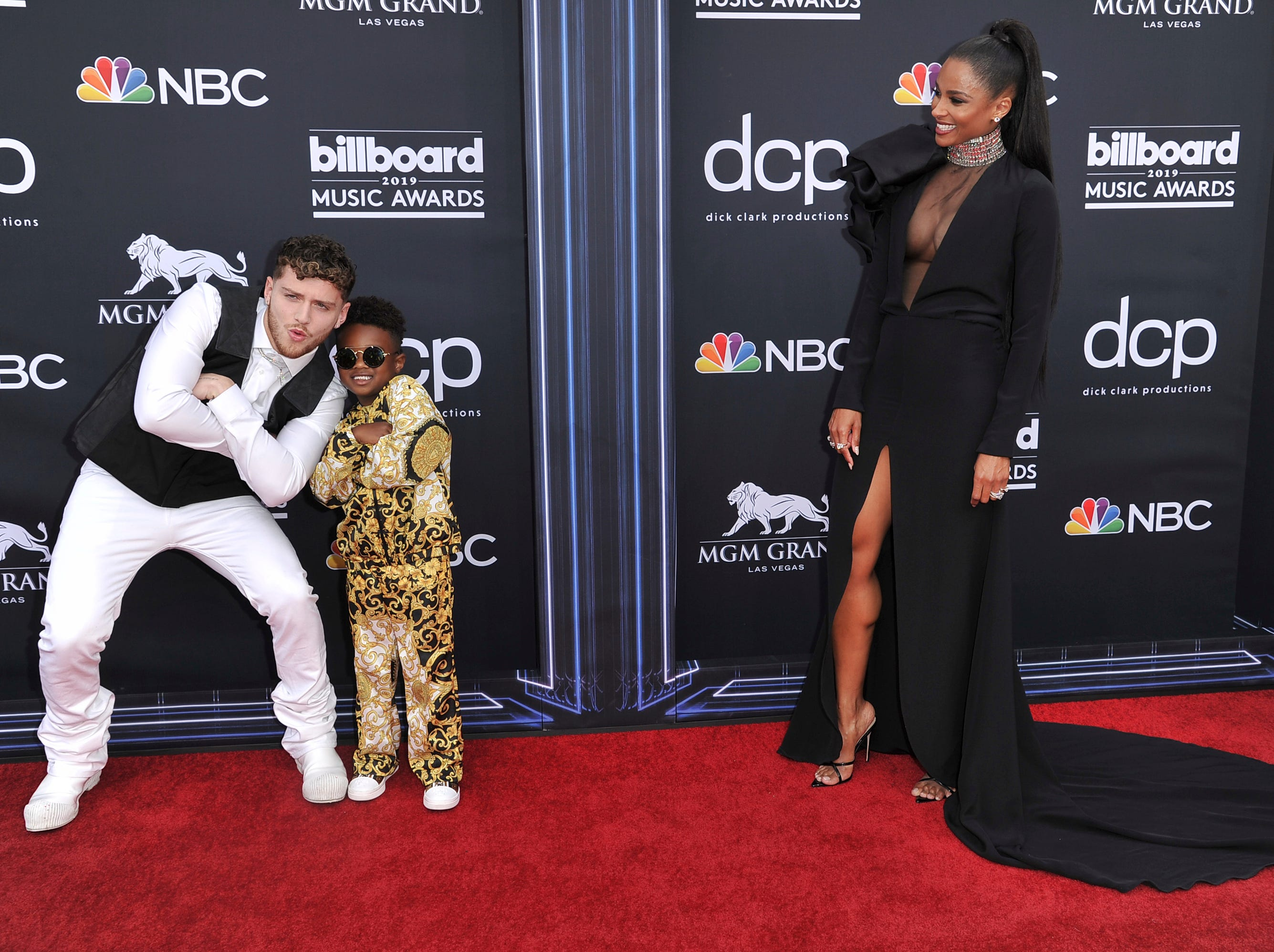 Ciara, right, looks on as Bazzi, from left, poses with her son Future as they arrive at the Billboard Music Awards on Wednesday, May 1, 2019, at the MGM Grand Garden Arena in Las Vegas.