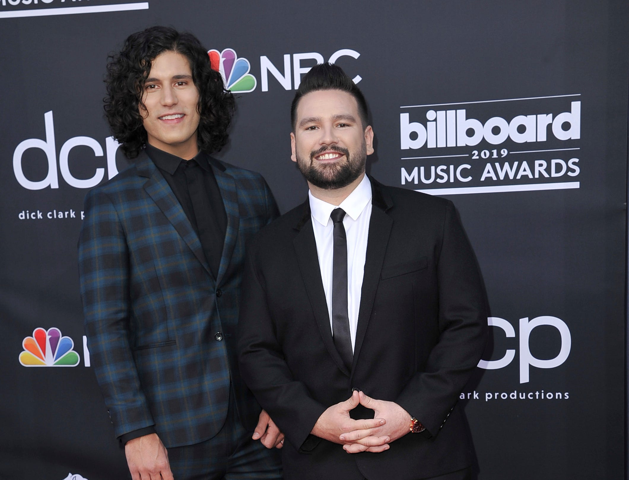 Dan Smyers, left, and Shay Mooney, of Dan + Shay, arrive at the Billboard Music Awards on Wednesday, May 1, 2019, at the MGM Grand Garden Arena in Las Vegas.