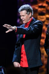 Randy Travis waves during the 35 Years of Friends: Celebrating the Music of Michael W. Smith concert at Bridgestone Arena in Nashville, Tenn., Tuesday, April 30, 2019.