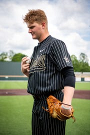 To focus himself, Vanderbilt pitcher Drake Fellows taps the ball on his chest at Charles Hawkins Field Wednesday, May 1, 2019, in Nashville, Tenn.